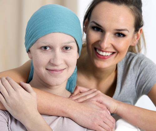 young cancer patient with caregiver