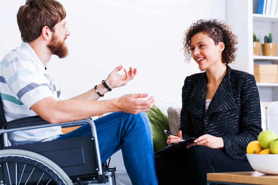 ms patient in wheelchair with caregiver